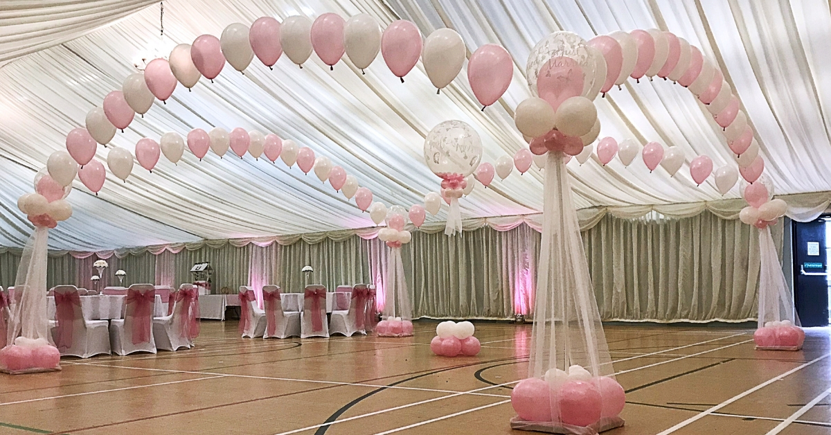 Balloon dancefloors need heavy base weights to stop the columns being pulled in by the latex arches.
